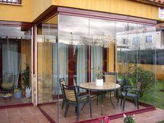 Cerramiento de balcon con cortinas de cristal