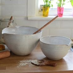This beautiful stoneware mixing bowl, has been hand-thrown and finished in a natural, rustic white glaze.Size: Small - D20.5cm x H12.5cm (£35) Large - D26cm x H16cm (£49.75)These stunning hand-crafted mixing bowls have been designed to be generously deep and include a useful pouring lip. Each bowl has a very special glazed exterior, with natural speckled detail in the clay which give every piece a unique appearance and studio pottery feel. The potter's throwing rings can be seen ...