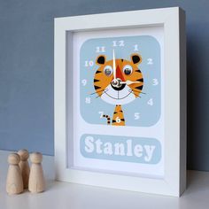 personalised framed animal clock by stripeycats   notonthehighstreet.com
