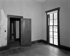 Full height windows with ornamental frieze in the master bedroom. Manship House Museum: Jackson, MS