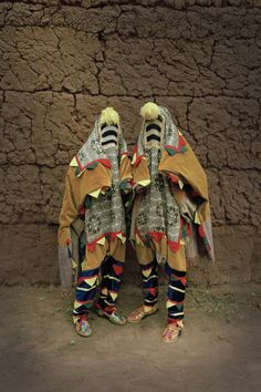Global African Artists Explore The Meaning Of Disguise In The 21st Century. Untitled, Egungun Series, 2011, Leonce Raphael Agbodjelou, Benin, b. 1965, digital exhibition print, 59 x 39 1/4 in., loan from the artist and Jack Bell Gallery, London. © Leonce Agbodjelou, Photo courtesy of Jack Bell Gallery, London.    The Western mythos around masks is familiar, unconcealed. Don a disguise, whether a helmet for a sports match or a costume for a masquerade, and be liberated, freed from a fixed…
