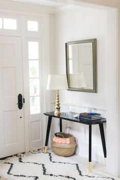 Black paint + gold leaf = a DIY entryway table hack that's simple and sure to wow your guests.