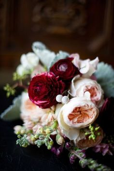Love the peonies. For the wedding flowers, thinking pink and cream with sage-colored greenery and pops of burgundy to tie in the surroundings.
