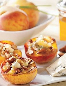 Grilled peaches with blue cheese, nuts and honey. Colorful appetizer or dessert recipe.