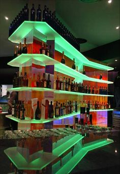 Illuminated acrylic bar shelving with LED's. ACRYLITE® Satinice velvet textures two-sided acrylic #0F00DC was considered for long-term design and energy efficiency. www.acrylite-shop.com?expa=pinterest.interiors