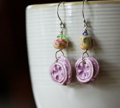 Ceramic charms by Jenny Davies-Reazor, lampwork by Jen Cameron (Glass Addictions), swarovski crystals, argentium silver wire and ear wires.   June 2013 Component of the Month Reveal by GlassAddictions, via Flickr