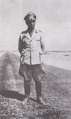 """Erwin Rommel on the 'Via Balbia', the road to Egypt.Built under the rule of the Italian dictator Benito Mussolini in colonial Italian Libya in the 1930s, it was named Via Balbia' (or Litoranea Balbo) in honor of governor-general Italo Balbo, but renamed to """"Libyan Coastal Highway"""" after independence and enlarged."""