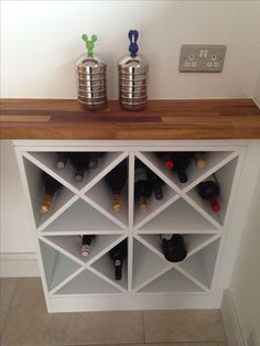 DIY wine rack -- make two of these on either side and one in the middle with normal shelving for a custom bar/side table