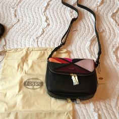 Fossil Preston flap cross body small Fossil small Preston multi color. Top flap pocket is the entire length of the purse. Also had a zipper that you can extend the purse a little Fossil Bags Crossbody Bags