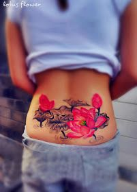 pink lotus flower tattoo on the lower back