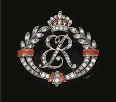 Enamel and diamond royal presentation brooch, c1940. Designed as a graduated wreath centring on ER for Elizabeth Regina, Queen Elizabeth, consort to King George VI, surmounted by a crown, set with rose and single-cut diamonds, further decorated with red guilloché enamel, fitted case Carrington & Co Ltd., 130 Regent St