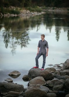 Matt Shumate photography senior boy session standing on rocks by the river scenic background in Spokane WA
