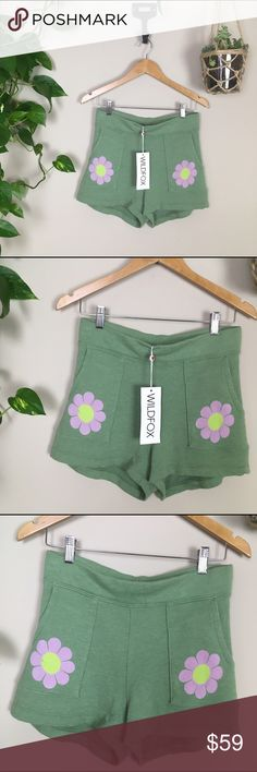 Wildfox shorts!!! ✨Wildfox Couture Flower Girl bottoms in grass stain green😝…These retro cuties have a longer, roomier fit so ya can move and groove, constructed from a light, burnout terrycloth blend. Has a wide elastic banded waist to keep 'em on, and two extra large front pockets with cute daisies printed on them.   Materials: 85% Cotton, 15% Polyester Machine Washable  New With tags at a discounted price 😍 Wildfox Shorts