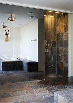 Beautiful slate bathroom. Use Bellstone's North Country Slate on your floors and walls to get this beautiful and natural look & feel.