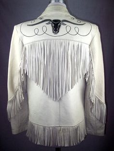 "Patsy Cline-style vintage fringe jacket. Front and back western longhorn cows in black leather with white chainstitch embroidery, along with swirly ""rope"" chain stitch embroidery."