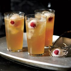 Dark and Stormy Death Punch | This is Grace Parisi's take on the Dark and Stormy, a classic rum and ginger beer drink. Floating in the punch bowl are round ice cubes made with lychee syrup and lychees stuffed with brandied cherries, which have an uncanny resemblance to eyeballs.
