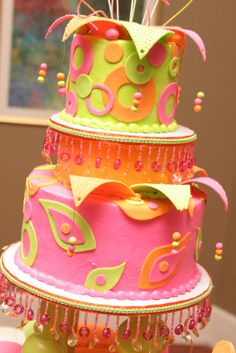 """This cake is the potential """"pas de resistance"""" for a wedding of bright pastels.  Put the girls in assorted bright pastel chiffon gowns, and keep everything else toned down and clear.  So fun! from the """"colors of love"""" cakes page at TheOneWedding.com"""