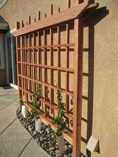 Garden trellis on the side of a house or garage. More #pergolaideas #GardenLandscapingHouse