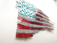 Tattered American flag. This flag is colored with metal stains and then clear coated with a 2 part clearing process. Dimensions are 24 wide tall by 13.5 inches tall. No 2 flags are the same.