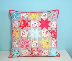 Patchwork Cushion by Strawberrylicious  | Flickr ... Love all the colors against the natural linen and the added squares are great!