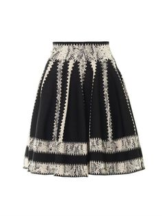 £562.00 Sarah Burton showcased a well of technique and precision in her SS14 collection for Alexander McQueen. This skater skirt is one such example elevated to a whole new level of luxe with striped panels of snake-effect jacquard. The full silhouette is perfectly in tune with the season and lends itself well to peplum tops and jackets.