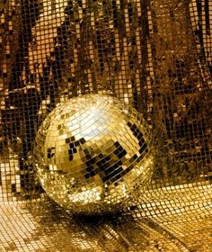 Golden disco mirror ball reflect light on glitter canvas background Stock Photo