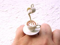 This is soooo cute! There is a cup of tea with cream being poured! Very kawaii! #etsy #jewelry It is on a silver tone adjustable band that will fit most ring sizes. It measures about 3 cm wide (1.2 inch) and 4 cm high (1.6 inches). SouZouCreations' products are made with attention to detail, creativity and long lasting dependability.