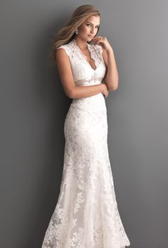 Brides: Allure Romance . This gorgeous style is created from a rich lace applique on soft net. The sculpted neckline features scalloped straps and keyhole back. The empire waist is accented with a Swarovski crystal detail and satin band.See Allure Bridals on YouTube