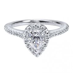 Are you in love as much as we are with this 14k White Gold Contemporary Halo Engagement Ring?