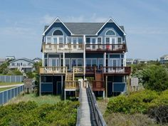 Paradise Point East located at The Point - 4 bedrooms, 3 baths and Pet Friendly! Covered porch with furniture, enclosed hot/cold outside shower. Boardwalk to the beach with dune deck to take in those beautiful sunset views. Panoramic ocean view.