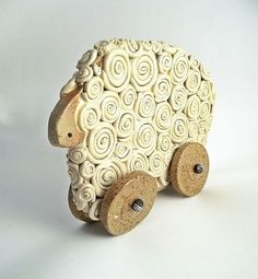 Awwwww! I think this is really cute! Ceramic Sheep on Wheels for Your Home - Home Decor - Ceramic Toy. €23,00, via Etsy.