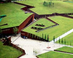 designed by cai yongjie, the 'wenchuan earthquake memorial museum' takes the form of a cracked landscape.