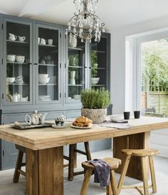 This country dining room has used reclaimed wood to create a stunning table and chairs - it really gives such an impact. The furntiture is character-packed and the more modern details, like the chandelier, give the room a more up-to-date feel too.