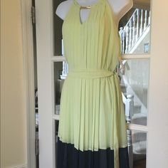 "1 Day SaleJessica Simpson Halter Color Block Dress A lime  green and navy pleated color Block dress by Jessica. Size : 6 . Halter style top with back neck 3 button closure. Extra button enclosed. Elastic waistband with tie belt . Above knee mini. 100% Polyester. Brand new with tags. . Total length 39"" Bust 34-35"" waist 28"" Jessica Simpson Dresses"