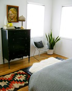 kilim rug, dresser, plant
