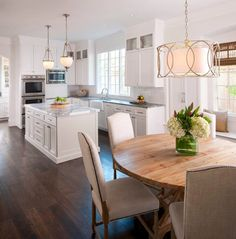 Rectangular chandelier over table kitchen traditional with statuary white marble visual comfort glass cabinets