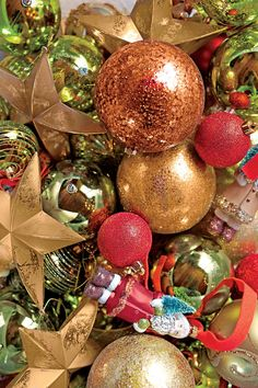 Ornaments - The Ultimate Holiday Decorating Guide - Southernliving. The key to a perfectly imperfect-looking tree? A smartly curated mix of ornaments. We advise a five-type formula: three sizes of balls in shades that coordinate with your chosen palette, a star shape for edge, and a few one-of-a-kind ornaments for a collected, personal feel. Select ornaments in an array of reflective finishes to bounce light around the room and give the tree a layered, sparkly look.