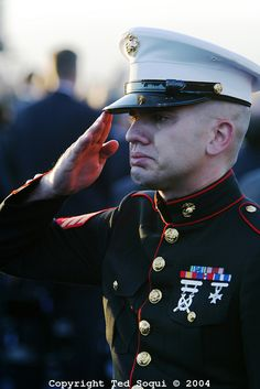 Ronald Reagan Funeral/// Marine Sgt. Ethan E. Rocke, sheds tears while he salutes and pays his respect to one of the greatest Presidents in the history of our Republic.