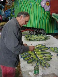 Painting larger than life flowers.