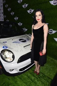 Best dressed at the 2013 Grammy Awards: MINI and Dita Von Teese.    See who joined her on Facebook.