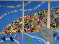 Whale mosaic made of beach trash.
