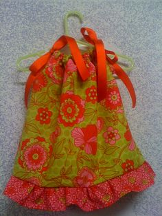This is a red, hot pink and lime dress with an abstract flower pattern!!  RED ribbons.  My iphone doesn't shoot red too well!!