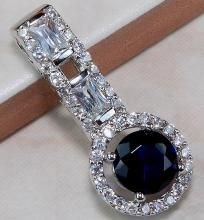 WELCOME TO CINDERELLA'S REVENGE  ~Cool Stuff at Cooler Prices for the Coolest People~  PLEASE READ ALL INFO BELOW! THANKS!  A BEAUTIFUL & ELEGANT SAPPHIRE & WHITE TOPAZ PENDANT SET IN A MODERN 925 STERLING SILVER SETTING. THIS PENDANT IS APPROXIMATEL...
