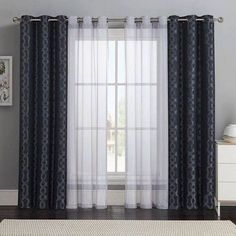 Beautiful curtains design. Bold patterns and sheer solids for the living room windows.