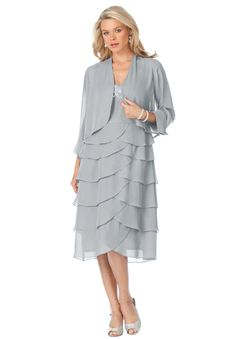 """Layers and layers of tiers on this plus size jacket dress create a magical silhouette. bolero jacket has 3/4-length sleeves with turn back cuffs with button detailsjacket is about 20"""", meeting you at your natural waistthe alluring shift dress has plenty of room, giving an effortless fit that creates a flawless look (and total comfort)sleeveless style keeps you cool and comfortable; the armholes were designed for you to move with easeelegant beading at sweetheart neckline elongates and ..."""