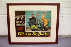"This item is particularly special and very hard to find. Original ""Roman Holiday"" lobby card as used in the cinemas at the time the film was released. Great art work with the 3 main characters all perched on the Vespa. Excellent condition and framed ready to hang.    Pleased contact us for costs for delivery within the UK or else collection can be arranged.  £450"