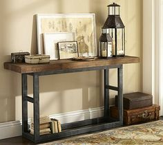 Griffin Console Table #potterybarn Behind sofa with poufs below