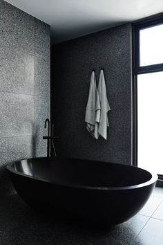 One stand-out feature in this modern master bathroom is the oval-shaped black freestanding bathtub. One stand-out feature in this modern master bathroom is the oval-shaped black freestanding bathtub. Chiaroscuro, Interior Exterior, Bathroom Interior Design, Timber Battens, Timber Staircase, Melbourne, Palette, Dark Interiors, My New Room