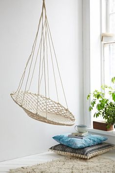"<ul> <li>Curl up in this woven hanging chair. Circular macramé silhouette with a looped top hang it from a sturdy hook indoors or out. Hardware not included.</li> <li>Content + Care</li> <li>Iron, cotton</li> <li>Wipe clean</li> <li>Imported</li> <li>Size</li> <li>Holds up to 200 lbs</li> <li>Dimensions: 30""l x 42""h</li> <li>Hanging height: 50""<"