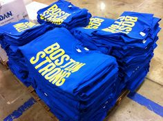 Stacks of Boston Strong shirts are printed for Ink to the People.  Proceeds help the One Fund Boston charity for the victims of the tragedy.  http://inktothepeople.com/marketplace/ink-detail/3731